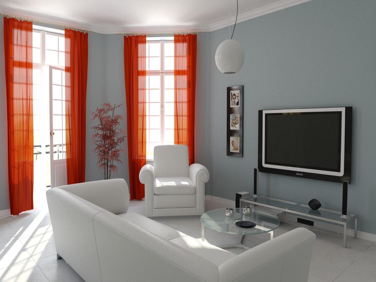 В интерьере маленькой гостиной неплохо использовать больше стекла